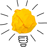 Yellow lightbulb made of crumpled paper